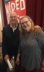 Kelly Kitchens works with new filmmakers and veteran actors alike. With John Cleese for the Dallas VideoFest's Ernie Kovacs Award Dec 2019.